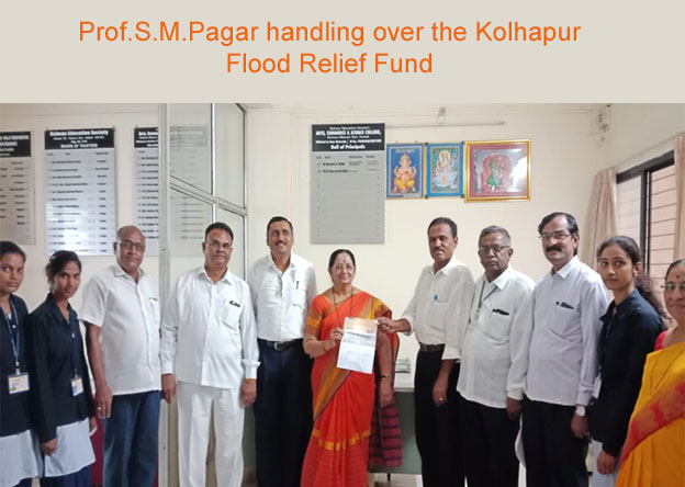 Prof.S.M.Pagar handling over the Kolhapur Flood Relief Fund